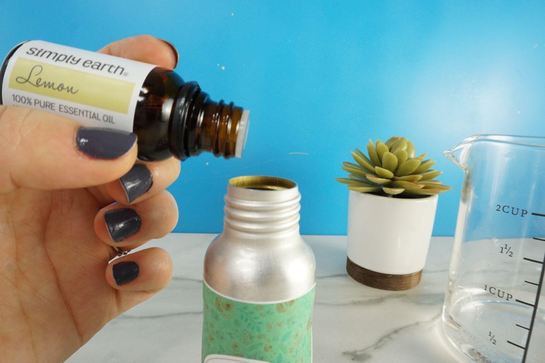 Add Lemon Essential Oil into the spray bottle.